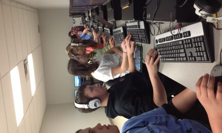 Eighth grade utilizing technology in class