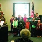 Students sing to the young at heart