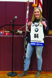 Photo by Gina Greco Maddie Phaneuf with one of her biathlon bibs, skis and rifle.