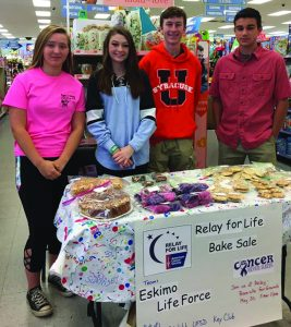 Photo submitted Hannah Kane, Lauren Beckingham, Tyler Rudolph, and Erik Lenci sell baked goods to raise money for Relay for Life. The team is also selling luminaries, contact Shawn Hansen at shansen.2018@towschool.org.