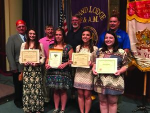 Photo submitted RW Carl Klossner, MSA and DDGM for the Oneida District who presented the Scottish Rite Scholarships stands with Lauren Beckingham, Alexandra R. DiOrio, Allyson Brosemer, and Chloe Brosemer. They stand with proud grandpas Donald DiOrio and Thomas Beckingham and father Wayne Beckingham.