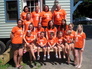 Photo submitted Girls' week out  Linda Polcaro Jackson, Barbara Polcaro Chase and Andrea Polcaro of Woodgate, along with family and friends from Rhode Island, North Carolina and various towns in upstate New York, celebrated their 15th annual Polcaro Family Girls' Week in mid-July. Many of them were seen around town wearing their bright orange reunion t-shirts.  They gather in the Adirondacks each year to celebrate, have a great time and then look forward to coming back next year. As usual they made sure to catch a movie at The Strand Theatre and enjoy shopping at the many stores in Old Forge. This year's photo was taken in front of a new tiny house at Bear Creek Carpentry Company in Woodgate.